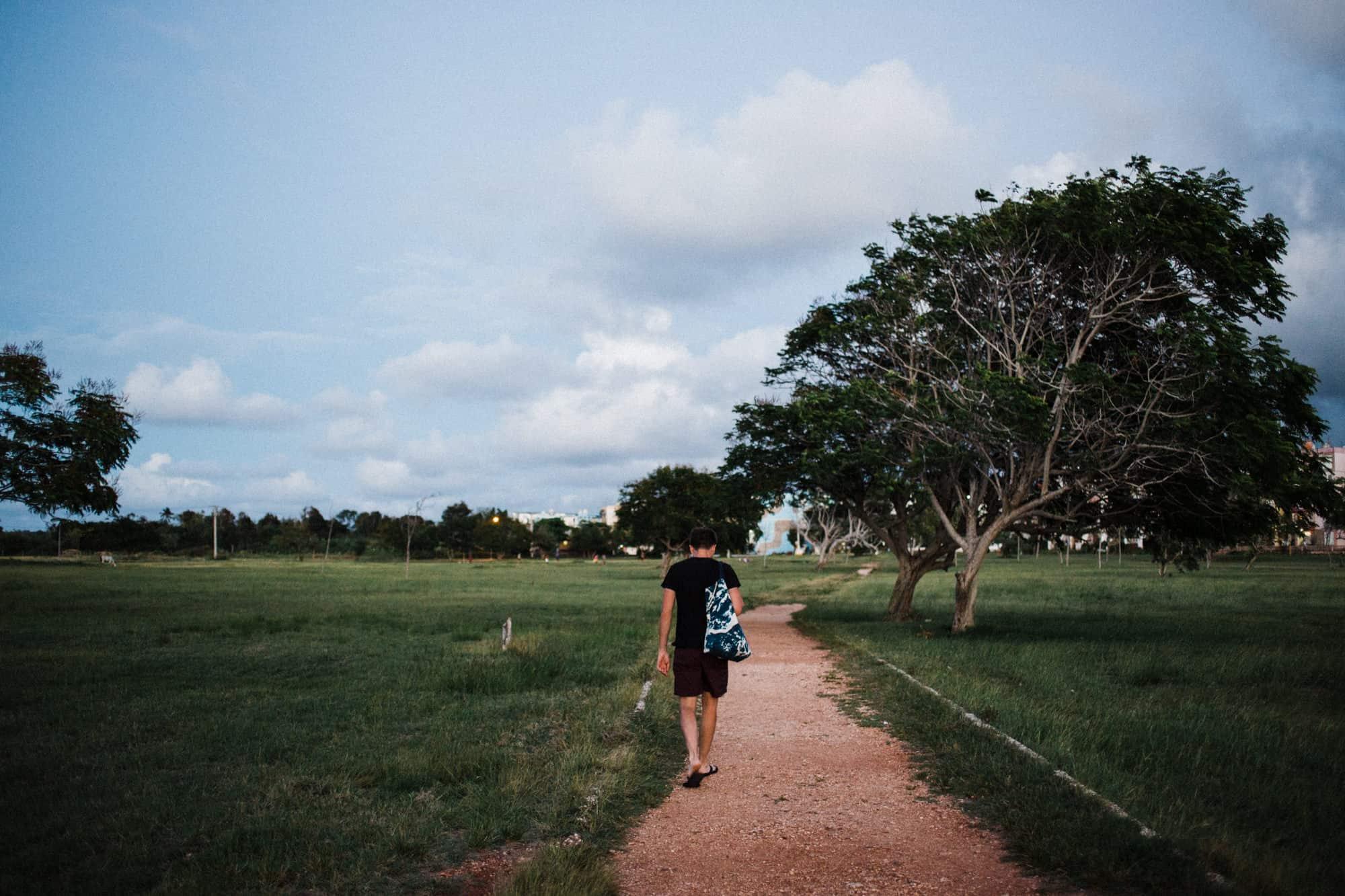 Man walking through a park in Cuba