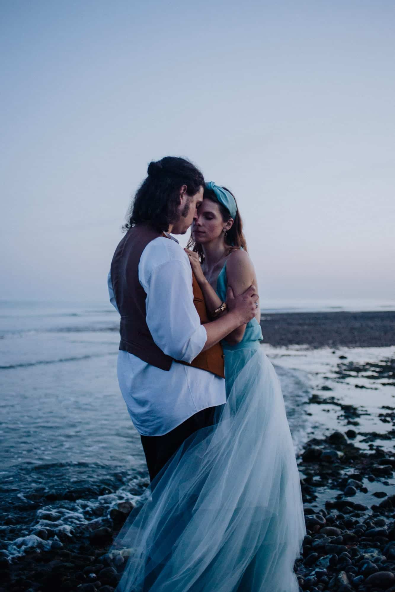 Wedding photo by the water's edge at Seven Sisters for a coastal elopement