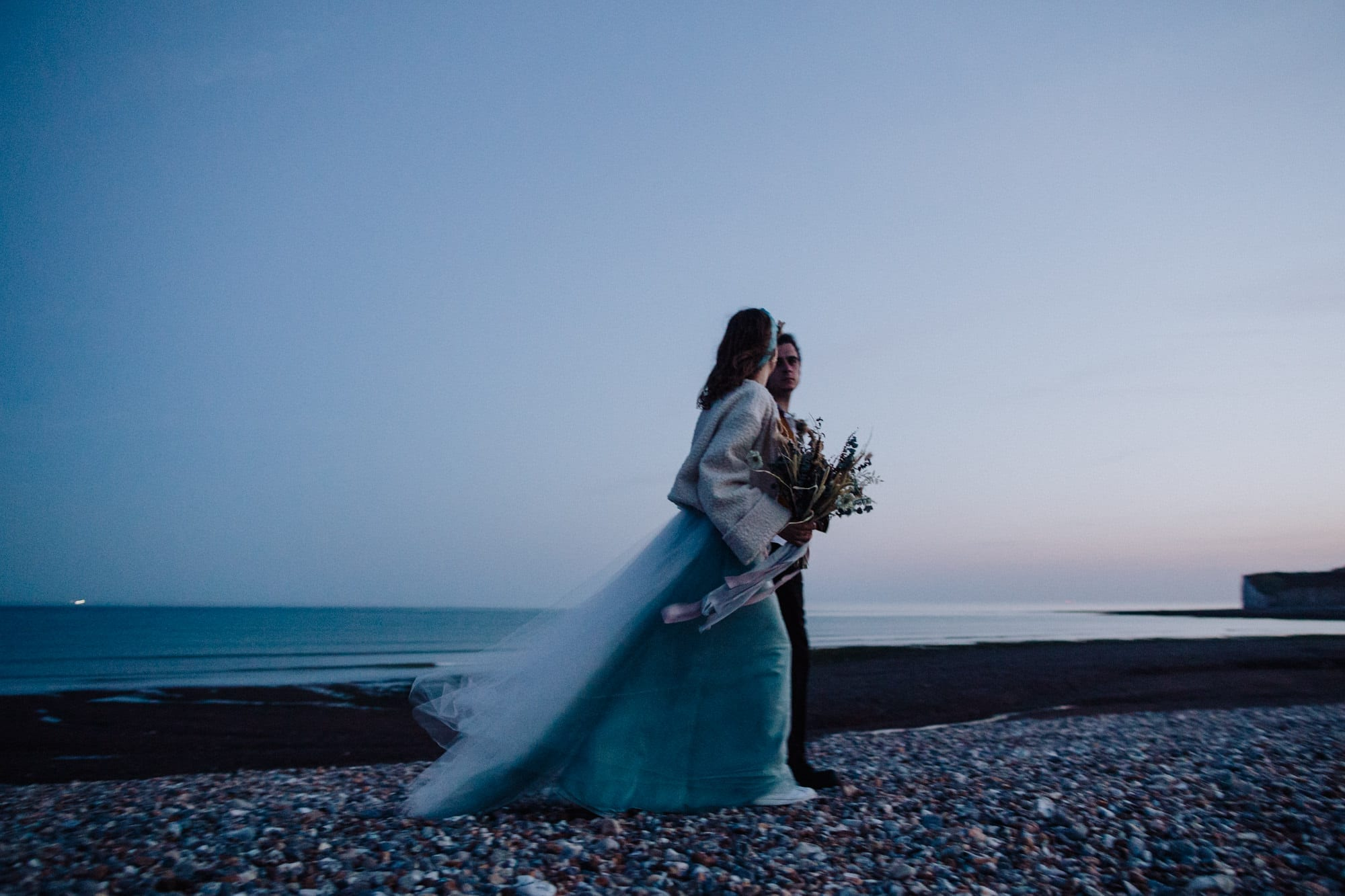 Wedding photo at dusk by the sea