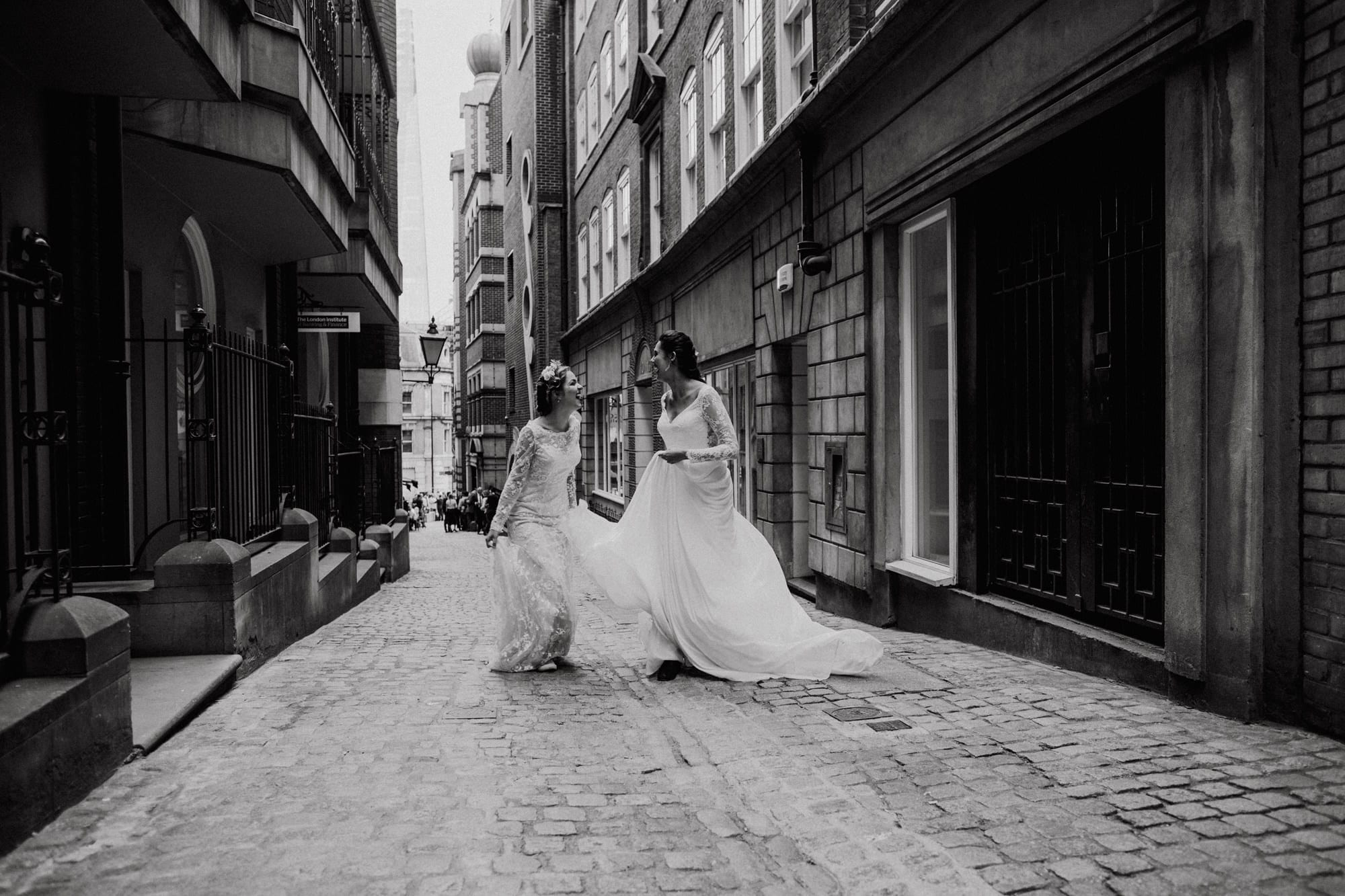 Two brides having fun on their wedding day in London